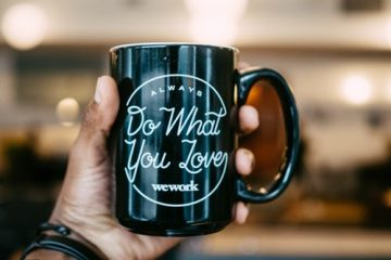 A mug with WeWork's slogan 'do what you love' on it